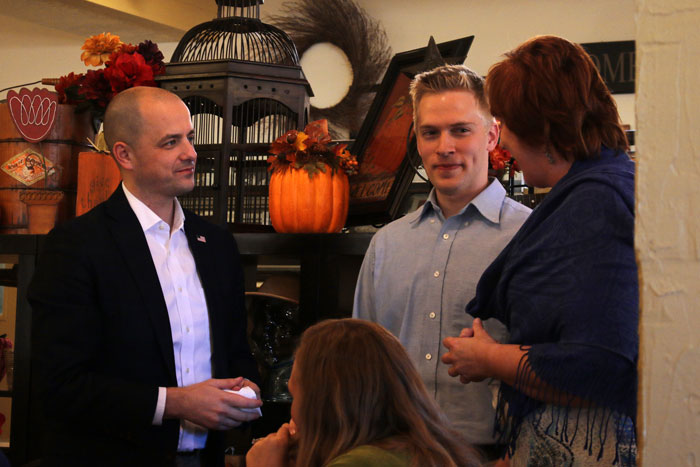 Presidential candidate Evan McMullin talking with two event attendees