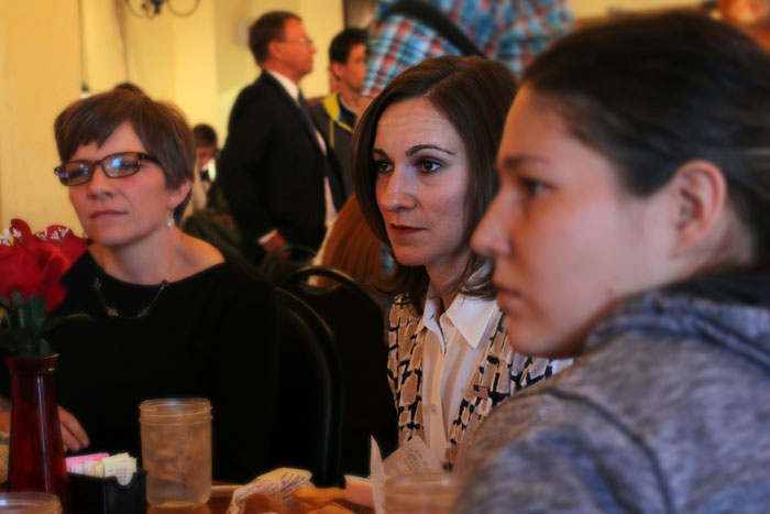 Vice Presidential candidate Miny Finn sitting with two women at the event